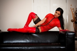 Jasmine jones  red thigh high worship. Well i know you PIGS are so weak for me in my long shiny PVC thigh high boots.  I know just how to tease you and wrap you around my little finger; that you will give me everything. I do exactly this in this picture set. Click and drool and fall deeper